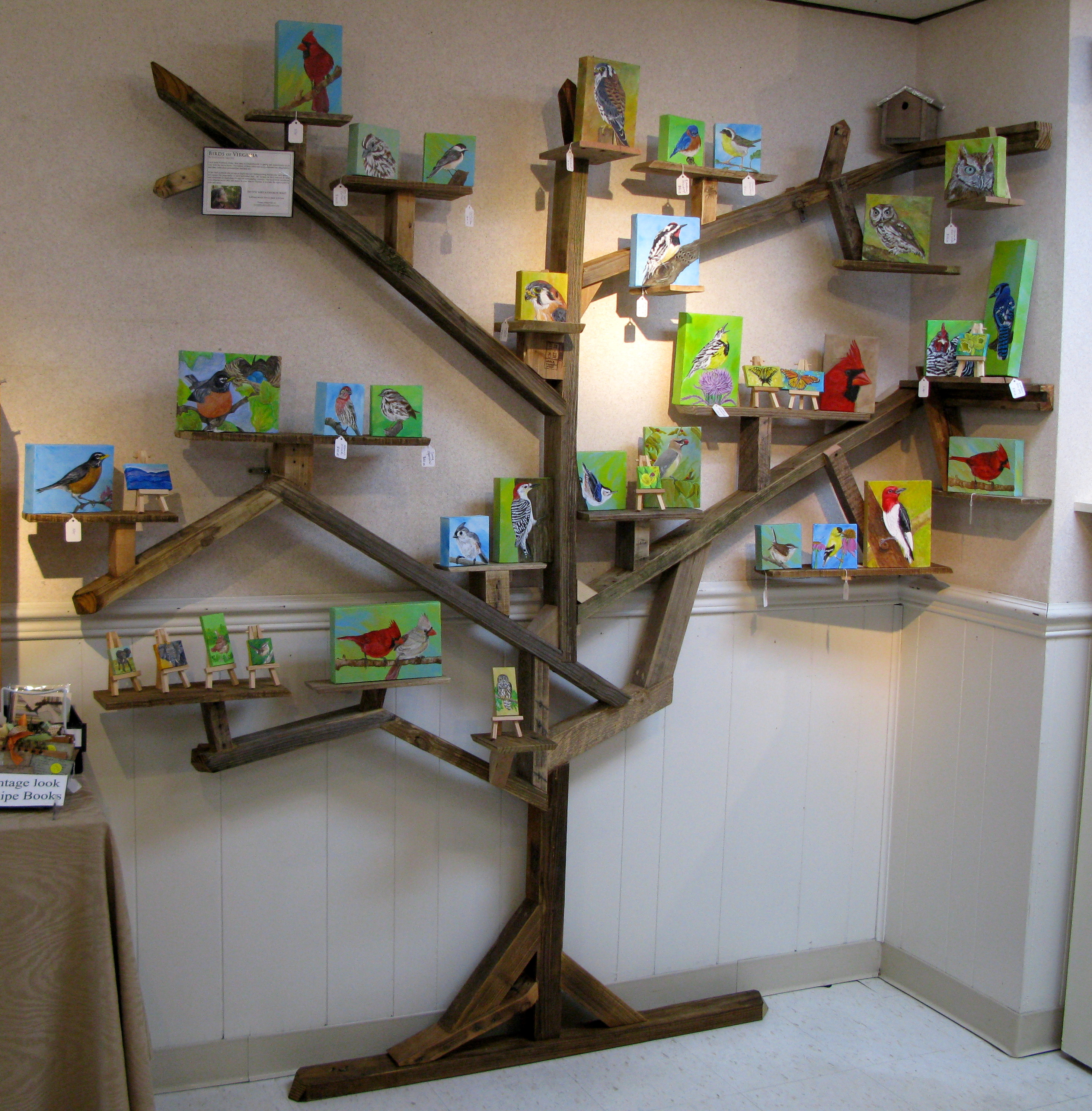 creative reuse photo tree display made from pallets